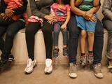 Decenas de niños migrantes en Long Beach dan positivo al coronavirus
