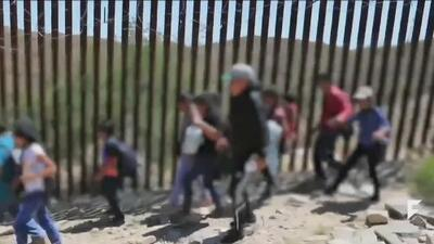 Coyotes crossing families at part of the border where wall cannot be built