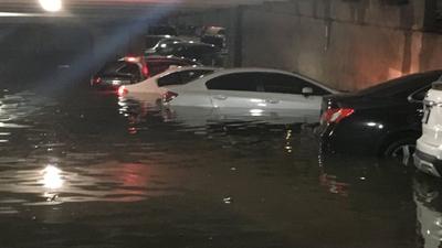 Heavy rainfall in Dallas left cars underwater in parking garage