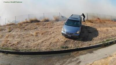Gerald Contreras helped guide drivers off-highway as grass fire approached