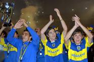 Boca Junior's player, left to right, Claudio Morel, Fernando Gago and Neri Cardozo, waves to fans, Sunday, May 14. 2006, after the match against Olimpo in Buenos Aires. Boca Juniors player celebrates after obtain the Argentine first divison championship. (AP Photo/Daniel Luna)