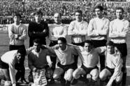 This is the Uruguayan National soccer team posing in the pitch of Montevideo's Centenario Stadium, Uruguay on August 10, 1969, before the Group XII World Soccer Cup qualification match against Chile. Uruguay won 2-0. Uruguay was the winner of Group XII topping the final standing with 7 points. In the same group, Chile (4 points) and Ecuador (1 point) were eliminated. Uruguay, which won the soccer Rimet Cup in the first edition, 1930, and fourth edition, 1950, are one of the three South American teams which will participate at the 1970 World Cup in Mexico. The other two are Brazil (1958 and 1962 Champions) and Peru. From left, standing: Omar Caetano, left half back from club Penarol; Ladislao Mazurkiewicz, goalie, from club Penarol; Roberto Matosas, fullback, from club Penarol; Luis Ubinas, right half back, from club Nacional; Atilio Anchetta, fullback, from club Nacional; Julio Montero Castillo, half back, from club Nacional. From left, squatting: Luis Cubillas, right winger, from club Nacional; Pedro Rocha, half back, from club Penarol; Sergio Silva, center forward, from club Cerro; Julio Cesar Cortez, from club Penarol; Ruben Bareno, left winger, from club Cerro. (AP Photo)