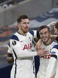 Tottenham's Harry Winks, 2nd from left, celebrates with team mates after scoring his side's third goal during a Group J Europa League soccer match and between Tottenham Hotspur and Ludogorets at the Tottenham Hotspur stadium in London, England, Thursday Nov. 26, 2020. (Ian Kington/Pool via AP)