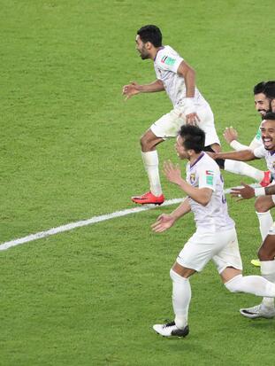 Soccer Football - Club World Cup - Al-Ain v Team Wellington - Hazza bin Zayed Stadium, Al Ain, United Arab Emirates - December 12, 2018 Al-Ain celebrate winning the penalty shootout REUTERS/Ahmed Jadallah