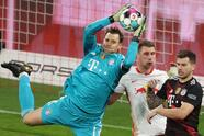 Bayern Munich's German goalkeeper Manuel Neuer (L) gets to the ball ahead of Leipzig's Hungarian defender Willi Orban (C) next to Bayern Munich's French defender Lucas Hernandez during the German first divison Bundesliga football match between RB Leipzig and FC Bayern Munich in Leipzig, eastern Germany, on April 3, 2021. - DFL REGULATIONS PROHIBIT ANY USE OF PHOTOGRAPHS AS IMAGE SEQUENCES AND/OR QUASI-VIDEO (Photo by ALEXANDER HASSENSTEIN / POOL / AFP) / DFL REGULATIONS PROHIBIT ANY USE OF PHOTOGRAPHS AS IMAGE SEQUENCES AND/OR QUASI-VIDEO (Photo by ALEXANDER HASSENSTEIN/POOL/AFP via Getty Images)