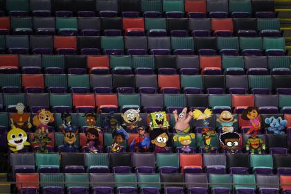 NEW ORLEANS, LOUISIANA - JANUARY 10: A detailed view of Nickelodeon cartoon characters cardboard cutouts are seen in the stands during the fourth quarter in the NFC Wild Card Playoff game between the Chicago Bears and the New Orleans Saints at Mercedes Benz Superdome on January 10, 2021 in New Orleans, Louisiana. (Photo by Chris Graythen/Getty Images)