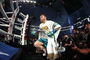 ARLINGTON, TEXAS - MAY 08: Canelo Alvarez enters the ring against Billy Joe Saunders before their fight for Alvarez's WBC and WBA super middleweight titles and Saunders' WBO super middleweight title at AT&T Stadium on May 08, 2021 in Arlington, Texas. (Photo by Al Bello/Getty Images)