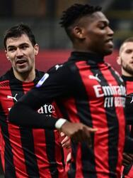 AC Milan's Ivorian midfielder Franck Kessie (R) celebrates after scoring a last minute penalty during the Italian Serie A football match AC Milan vs Udinese on March 03, 2021 at the San Siro stadium in Milan. (Photo by MIGUEL MEDINA / AFP) (Photo by MIGUEL MEDINA/AFP via Getty Images)