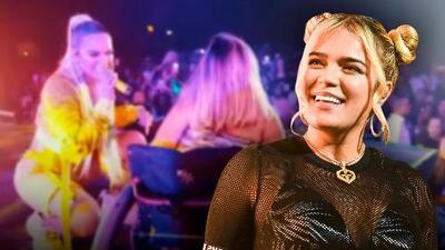 """En video: Karol G subió al escenario de un concierto a una fan en silla de ruedas que """"rompe"""" más que ella"""