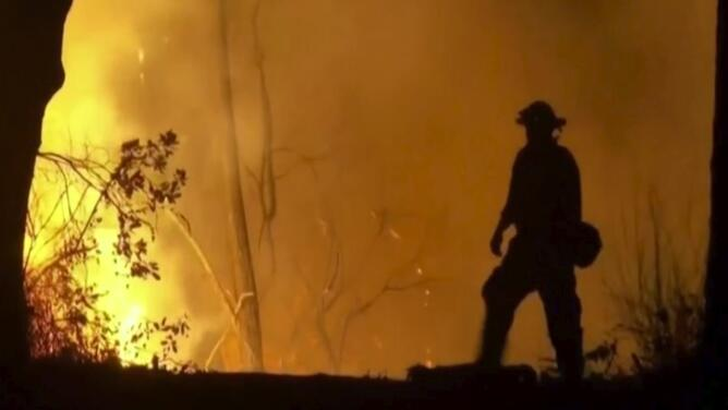 What role is climate change playing in the current wildfires?