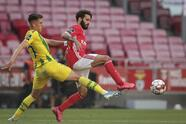 Benfica's player Rafa Silva, right, vies for the ball with Tondela's Richard Rodrigues during a Portuguese League soccer match between Benfica and Tondela in Lisbon, Portugal, Thursday, June 4, 2020. The Portuguese League soccer matches resumed Wednesday without spectators because of the coronavirus pandemic. (Tiago Petinga/Pool via AP)