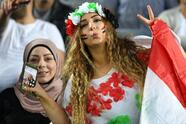 A Syrian fan shouts for her team prior to the 2018 World Cup football qualifying match between Australia and Syria in Sydney on October 10, 2017. / AFP PHOTO / SAEED KHAN / -- IMAGE RESTRICTED TO EDITORIAL USE - STRICTLY NO COMMERCIAL USE -- (Photo credit should read SAEED KHAN/AFP/Getty Images)