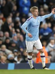 Manchester City's Oleksandr Zinchenko, left, celebrates scoring his side's first goal of the game with teammate Sergio Aguero during the English FA Cup third round soccer match between Manchester City and Port Vale at the Etihad Stadium, Manchester, England, Saturday, Jan. 4, 2020. (Martin Rickett/PA via AP)