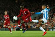 """Premier League - Liverpool v Huddersfield Town - Anfield, Liverpool, Britain - April 26, 2019 Liverpool's Naby Keita in action with Huddersfield Town's Juninho Bacuna REUTERS/Andrew Yates EDITORIAL USE ONLY. No use with unauthorized audio, video, data, fixture lists, club/league logos or """"live"""" services. Online in-match use limited to 75 images, no video emulation. No use in betting, games or single club/league/player publications. Please contact your account representative for further details."""