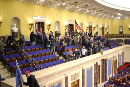 WASHINGTON, DC - JANUARY 06: Protesters enter the Senate Chamber on January 06, 2021 in Washington, DC. Congress held a joint session today to ratify President-elect Joe Biden's 306-232 Electoral College win over President Donald Trump. Pro-Trump protesters have entered the U.S. Capitol building after mass demonstrations in the nation's capital. (Photo by Win McNamee/Getty Images)