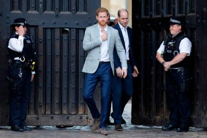 Britain's Prince Harry (L) and his best man Prince William, Duke of Cambridge, (R) arrive to greet well-wishers on the street outside Windor Castle in Windsor on May 18, 2018, the eve of Prince Harry's royal wedding to US actress Meghan Markle. - Britain's Prince Harry and US actress Meghan Markle will marry on May 19 at St George's Chapel in Windsor Castle. (Photo by Tolga AKMEN / AFP) (Photo credit should read TOLGA AKMEN/AFP/Getty Images)