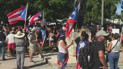 Con música y banderas, puertorriqueños protestan en Miami y siguen exigiendo la renuncia de Rosselló