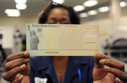 PHILADELPHIA, PA - JULY 18: In this photo illustration, Treasury employee Linda Tarkenton of Philadelphia, Pennsylvania holds a blank U.S. Treasury check before it's run through a printer at the U.S. Treasury printing facility July 18, 2011 in Philadelphia, Pennsylvania. U.S. President Barack Obama recently stated that he can't guarantee retirees will receive their Social Security checks in August if the House and Senate can not reach an agreement on reducing the deficit. (Photo by William Thomas Cain/Getty Images)
