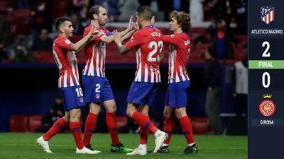 Con goles de Godín y Griezmann, el Atlético logró una sufrida victoria ante el Girona