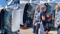 Hombre rompe un parabrisas con las manos para rescatar a una mujer atrapada