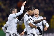 Legia's scorer Aleksandar Prijovic, center, and his teammates celebrate the opening goal during the Champions League Group F soccer match between Borussia Dortmund and Legia Warsaw in Dortmund, Germany, Tuesday, Nov. 22, 2016. (AP Photo/Martin Meissner)