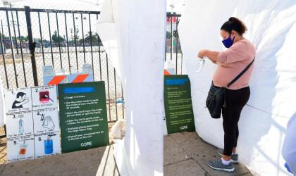 A woman, who just tested herself, places her mouth swab into a bag for testing at a pop-up Covid-19 Test site in Los Angeles, California on October 29, 2020, where the testing is walk-up only with no appointments necessary and results in 48 hours. - While cases of Covid-19 in California are up by about 38 percent from two weeks ago, the fewest fatalities from the coronavirus have been reported in a week since mid-April. (Photo by Frederic J. BROWN / AFP) (Photo by FREDERIC J. BROWN/AFP via Getty Images)