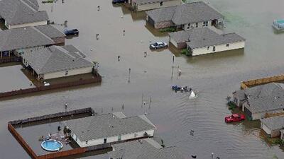 Estados Unidos, entre inundaciones, incendios y olas de calor