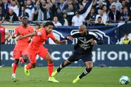 Girondins Jimmy Briand, right, and PSG Marquinos vie for the ball during the French League One soccer match between Bordeaux and PSG at the Matmut stadium in Bordeaux, southwestern France, Saturday, Sept. 28, 2019. (AP Photo/Bob Edme)