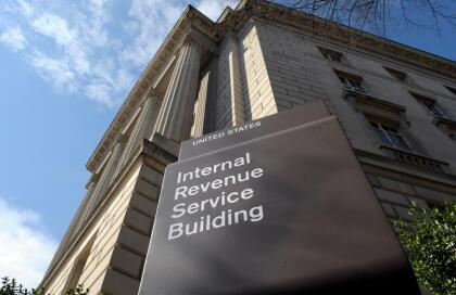FILE - In this photo March 22, 2013 file photo, the exterior of the Internal Revenue Service (IRS) building in Washington. Politicians love trying to use the tax code to highlight their goals to voters. This year, it's a battlefield between Hillary Clinton, who wants to boost levies on the rich to pay for expanding social programs and Donald Trump, who says cutting taxes would gird the economy. The clash has consequences for the rich, poor and those in the middle. (AP Photo/Susan Walsh, File)
