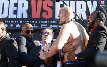 ¡No se quieren! Fury y Wilder se calentaron en el pesaje previo a su pelea en Los Ángeles