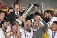 Sevilla players celebrate after winning the Europa League final soccer match between Liverpool and Sevilla in Basel, Switzerland, Wednesday, May 18, 2016. Sevilla won the match 3-1. (AP Photo/Martin Meissner)