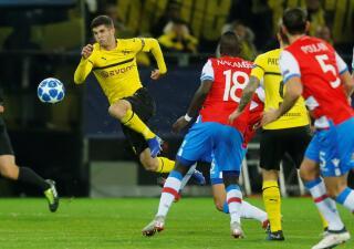 En fotos: un empate sella a Borussia Dortmund en octavos y a Brujas en Europa League