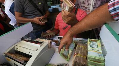 Venezuela deroga el control que penalizaba el cambio de moneda en el mercado negro