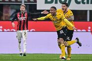 Udinese's Brazilian defender Rodrigo (R) celebrates after opening the scoring during the Italian Serie A football match AC Milan vs Udinese on March 03, 2021 at the San Siro stadium in Milan. (Photo by MIGUEL MEDINA / AFP) (Photo by MIGUEL MEDINA/AFP via Getty Images)