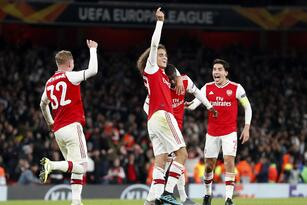 Arsenal's Nicolas Pepe, second from right, celebrates with teammates after scoring his side's third goal during the Europa League group F soccer match between Arsenal and Vitoria SC in London, Thursday, Oct. 24, 2019. (AP Photo/Alastair Grant)