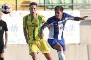 Porto's Otavio fights for the ball against Tondela's Richard Rodrigues during the Portuguese league soccer match between Tondela and FC Porto and Leipzig at the Joao Cardoso stadium in Tondela, Portugal, Thursday, July 9, 2020. The Portuguese league soccer matches are being played without spectators because of the coronavirus pandemic. (AP Photo/Luis Vieira)
