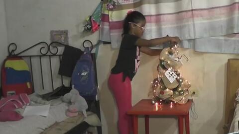 Venezolanos se preparan para una Navidad en medio de la escasez y la tristeza
