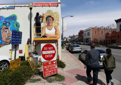 DENVER, CO - APRIL 04: Local artist Adolfo Romero paints a mural of Oscar Zeta Acosta, a Chicano lawyer, writer and activist on the south side wall of Su Teatro performing arts center April 04, 2018. (Photo by Andy Cross/The Denver Post via Getty Images)