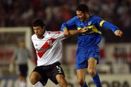 Diego Cagna, right, of Argentina's Boca Juniors, fights for the ball with Javier Mascherano of River Plate, during their Copa Libertadores semifinal game at Buenos Aires' Monumental Stadium, Thursday, June 17, 2004. (AP Photo/Natacha Pisarenko)