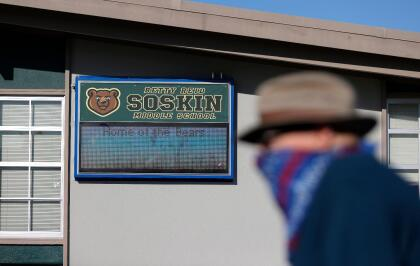EL SOBRANTE, CALIFORNIA - SEPTEMBER 22: A pedestrian walks by a new sign that is displayed during a ceremony for the newly renamed Betty Reid Soskin Middle School on September 22, 2021 in El Sobrante, California. Soskin had the school renamed after her on her 100th birthday. She currently works at the Rosie the Riveter/World War II Home Front National Historical Park where she leads tours, speaks to groups and answers questions about living and working in the area during World War Two. Soskin worked as a clerk for the Boilermakers A-36 in Richmond, California during the war. (Photo by Justin Sullivan/Getty Images)