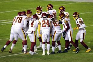 LANDOVER, MARYLAND - JANUARY 09: The Washington Football Team huddles during the game against the Tampa Bay Buccaneers at FedExField on January 09, 2021 in Landover, Maryland. (Photo by Rob Carr/Getty Images)