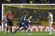 Mauro Zarate of Argentina's Boca Junior, center, celebrates his goal with teammate Pablo Perez, front, after scoring against Paraguay's Libertad during a Copa Libertadores soccer match in Buenos Aires, Argentina, Wednesday, Aug. 8, 2018. (AP Photo/Gustavo Garello)