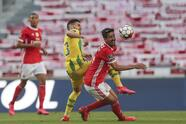 Benfica's player Andre Almeida, right, vies for the ball with Tondela's Yohan Tavares during a Portuguese League soccer match between Benfica and Tondela in Lisbon, Portugal, Thursday, June 4, 2020. The Portuguese League soccer matches resumed Wednesday without spectators because of the coronavirus pandemic. (Tiago Petinga/Pool via AP)