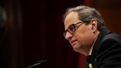 Cataluña juramenta como presidente a un secesionista que promete continuar el proceso de independencia