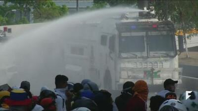"""Tensions continue in Venezuela as Maduro blames the US for """"coup"""""""