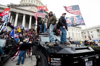 UNITED STATES - JANUARY 6: Trump supporters stand on the U.S. Capitol Police armored vehicle as others take over the steps of the Capitol on Wednesday, Jan. 6, 2021, as the Congress works to certify the electoral college votes. (Photo By Bill Clark/CQ-Roll Call, Inc via Getty Images)