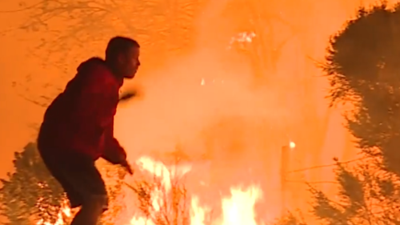 Man risks own life to save wild rabbit from California fire
