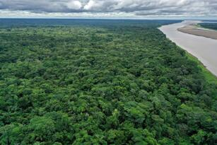 Aerial view of the Amazonas river near Leticia, Amazona sdepartment, Colombia on November 20, 2020. - Located on the banks of the Amazon river, an hour away by boat from Leticia, the capital of the Colombian department of Amazonas, the indigenous settlement of Nazareth of 1,035 inhabitants is one, if not the only, to accept homosexuals. (Photo by Raul ARBOLEDA / AFP) (Photo by RAUL ARBOLEDA/AFP via Getty Images)