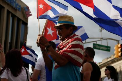 A man holds a Cuban flag during a protest showing support for Cubans demonstrating against their government, in Union City, New Jersey, on July 18, 2021. - Cuba's President Miguel Diaz-Canel on July 17 denounced what he said was a false narrative over unrest on the Caribbean island, as the Communist regime vigorously pushed back against suggestions of historically widespread discontent. (Photo by Kena Betancur / AFP) (Photo by KENA BETANCUR/AFP via Getty Images)