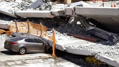 Multan a cinco compañías por violación de normas en relación con el derrumbe del puente de FIU